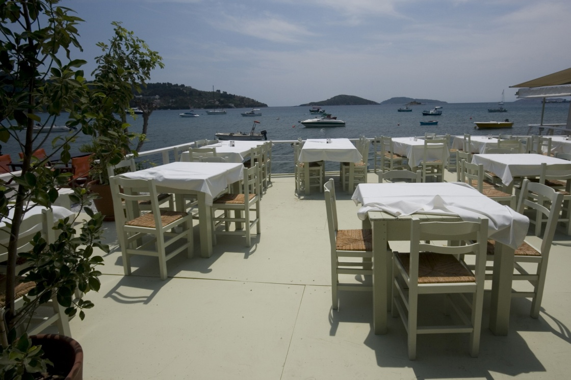 'Dining tables in local restaurant with a view of the sea Skiathos, Greece' - Σκιαθος